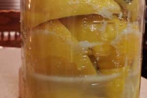 half gallon glass jar full of salted lemons