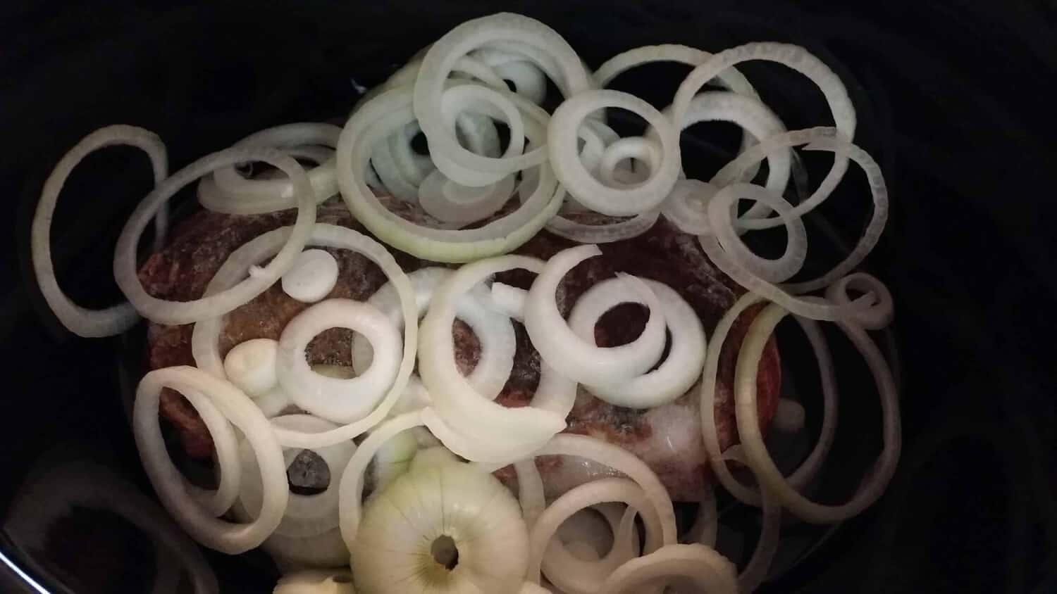 meat and onions for Crockpot Venison Goulash