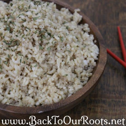 Homemade Organic Instant Rice Rehydrated in wooden bowl with red chopsticks