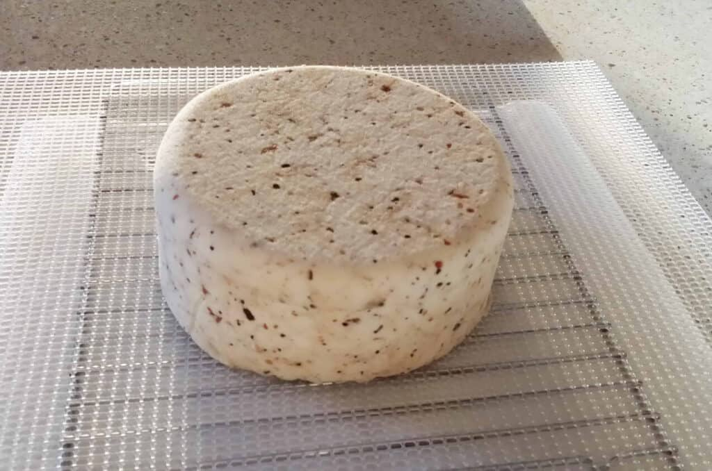 Pepper Jack cheese drying on plastic mat