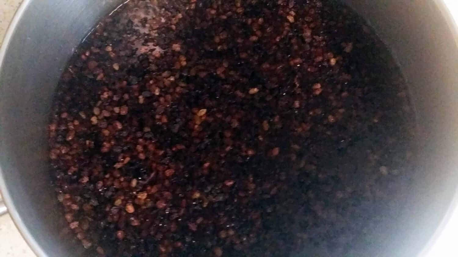elderberries rehydrating in pot of water