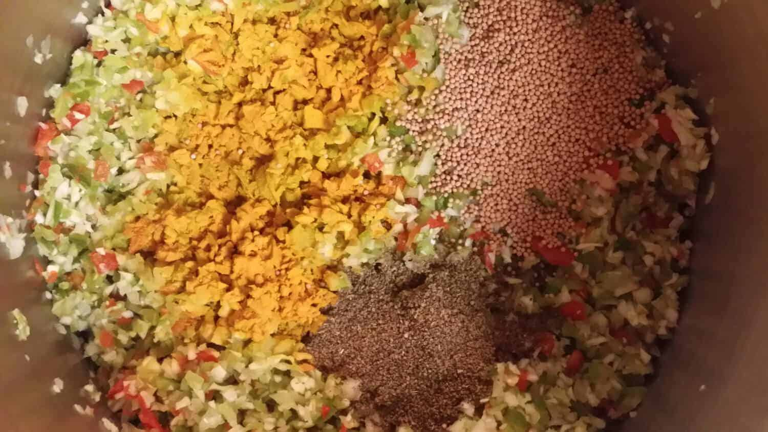 adding the spices to the sweet pickle relish