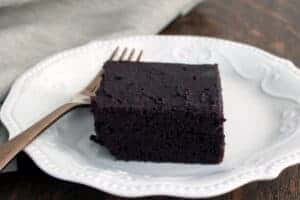chocolate cake on white plate with fork