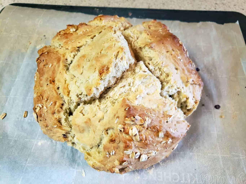 baked sourdough soda bread on baking sheet