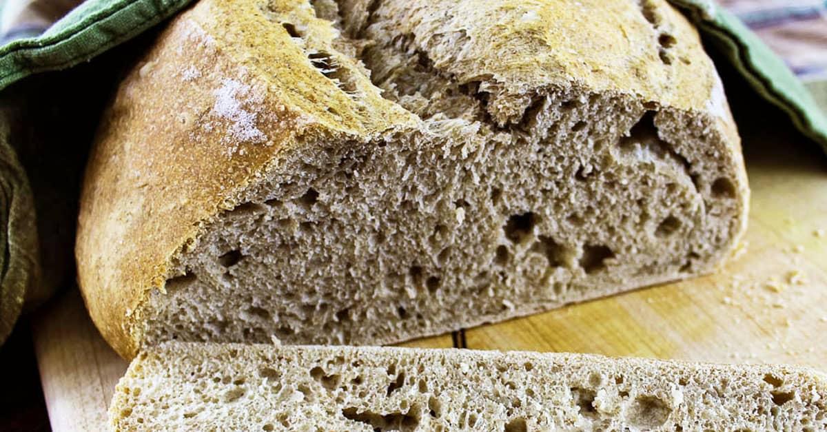 Sliced bicket dough bread on cutting board