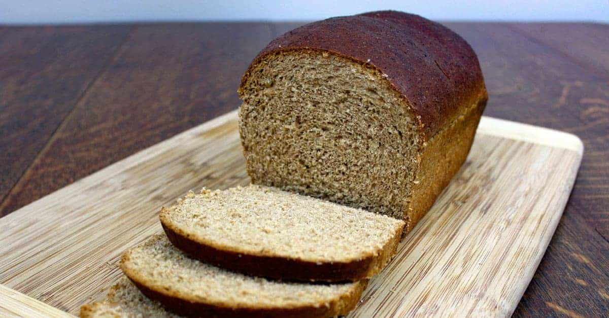 sliced Molasses Whole Wheat Bread on wooden cutting board