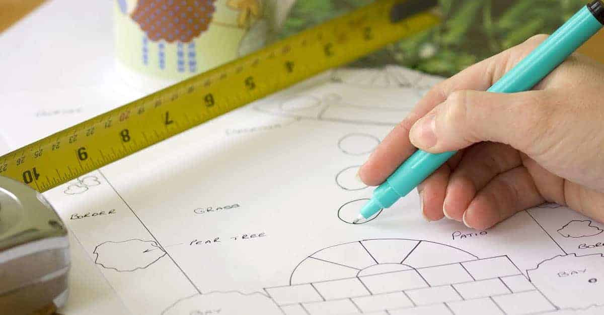 garden plan and measuring tape