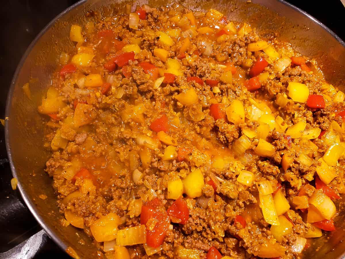 rice, ground beef, onions, garlic, and marinara sauce in skillet