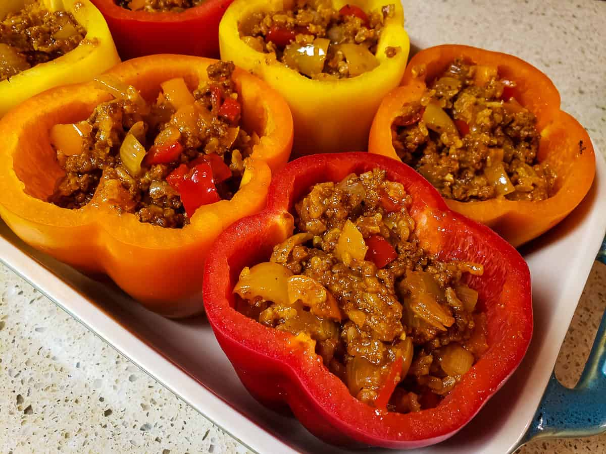 Meat mixture in red, oragn, and yellow bell peppers