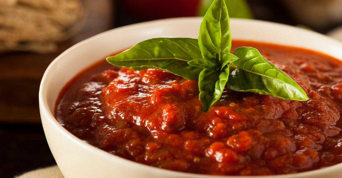 Marinara Sauce Recipe in white bowl with basil