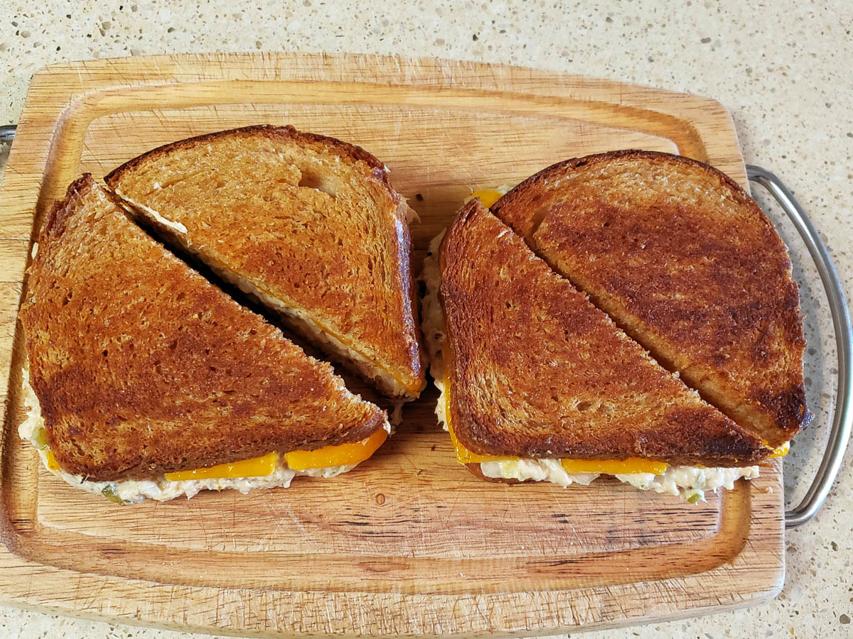 Simple Tune Melt Sandwiches on cutting board, cut into triangles