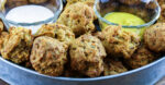 Sourdough Sausage Balls with dipping sauces in glass bowls